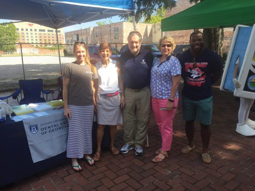 President Brooks Keel and First Lady Tammie Schalue at DCG booth at the Saturday Market