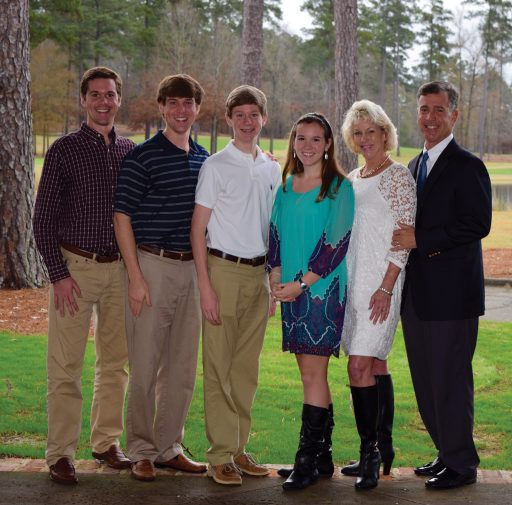 Dr. Mark Newton (right) with his family, Bradley, David, Daniel, Christy and wife Joni.