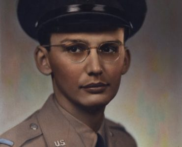 The solemn little boy grew up to be a slim, serious teenager sporting round  glasses and a neatly combed hairstyle, part of the class of '44 at the new Gray High School.