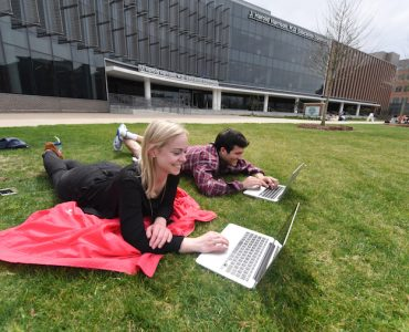 Students on lawn of Harrison Education Commons