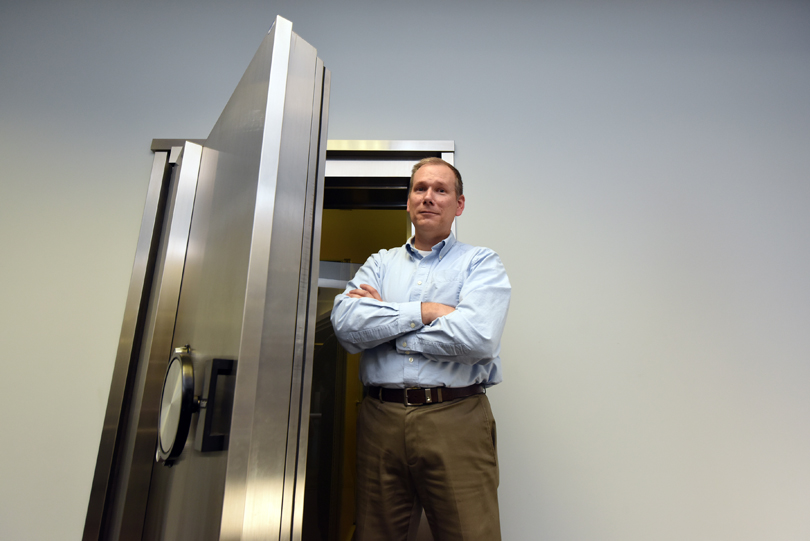 Michael Nowatkowski stands by a safe door