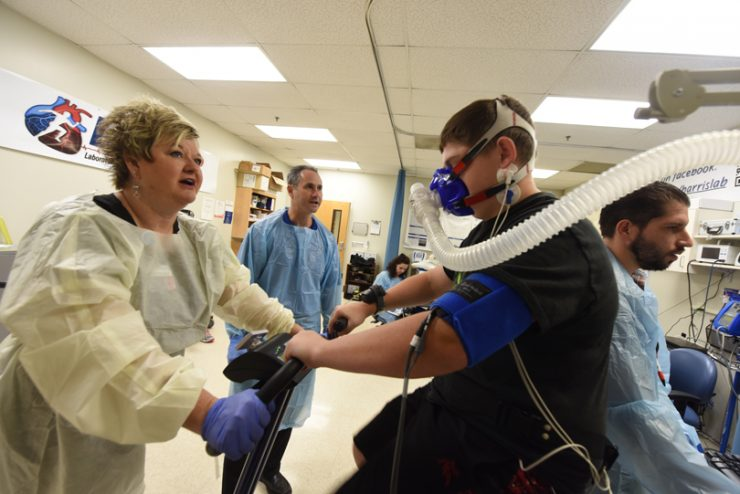 Respiratory therapist Reva Crandall, Dr. Ryan Harris, vascular technologist Marsha Backburn, study participant Damon Jenks, and research associate Jacob Looney