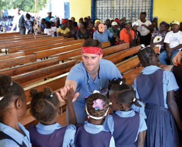 Ben Collins (Class of 2018) greets children in Haiti. Submitted photo