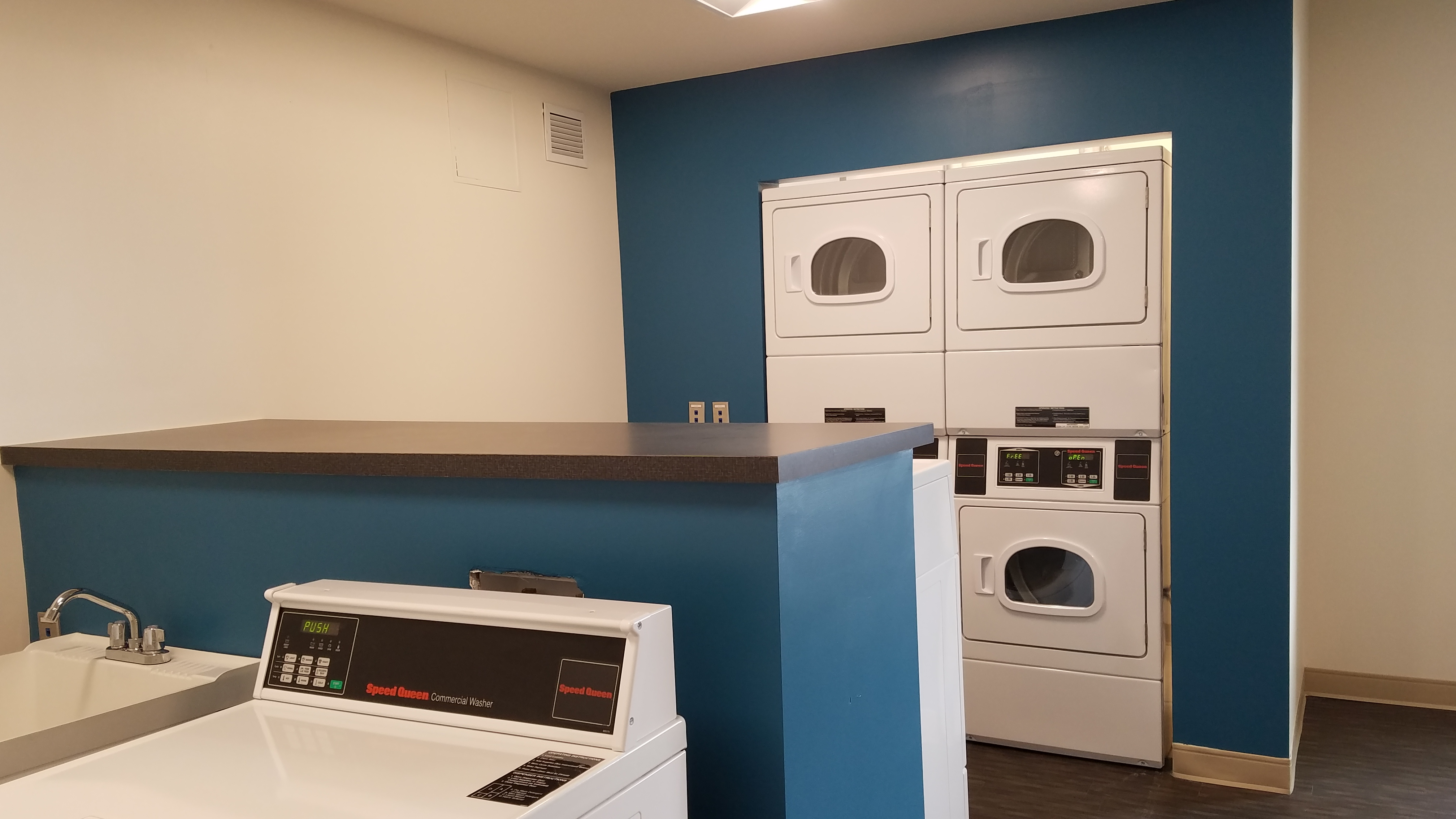 App-monitored units in the laundry room at Oak Hall