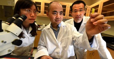 Dr. Yaoliang Tang (center) with research assistants Drs. Zixin Chen (l) and Chengwiei Ju