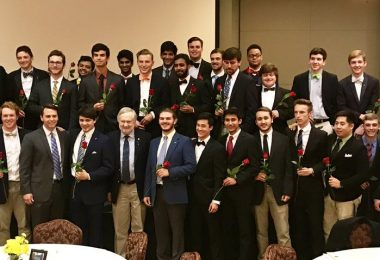 President Brooks Keel (center) poses for a photo with Pi Kappa Phi founding brothers on  Saturday, Nov. 19.