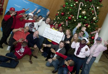 Children's Hospital of Georgia and iheart radio staff celebrate surpassing last year's Radiothon total by $10,000.