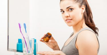 Woman Taking Her Vitamins In The Morning