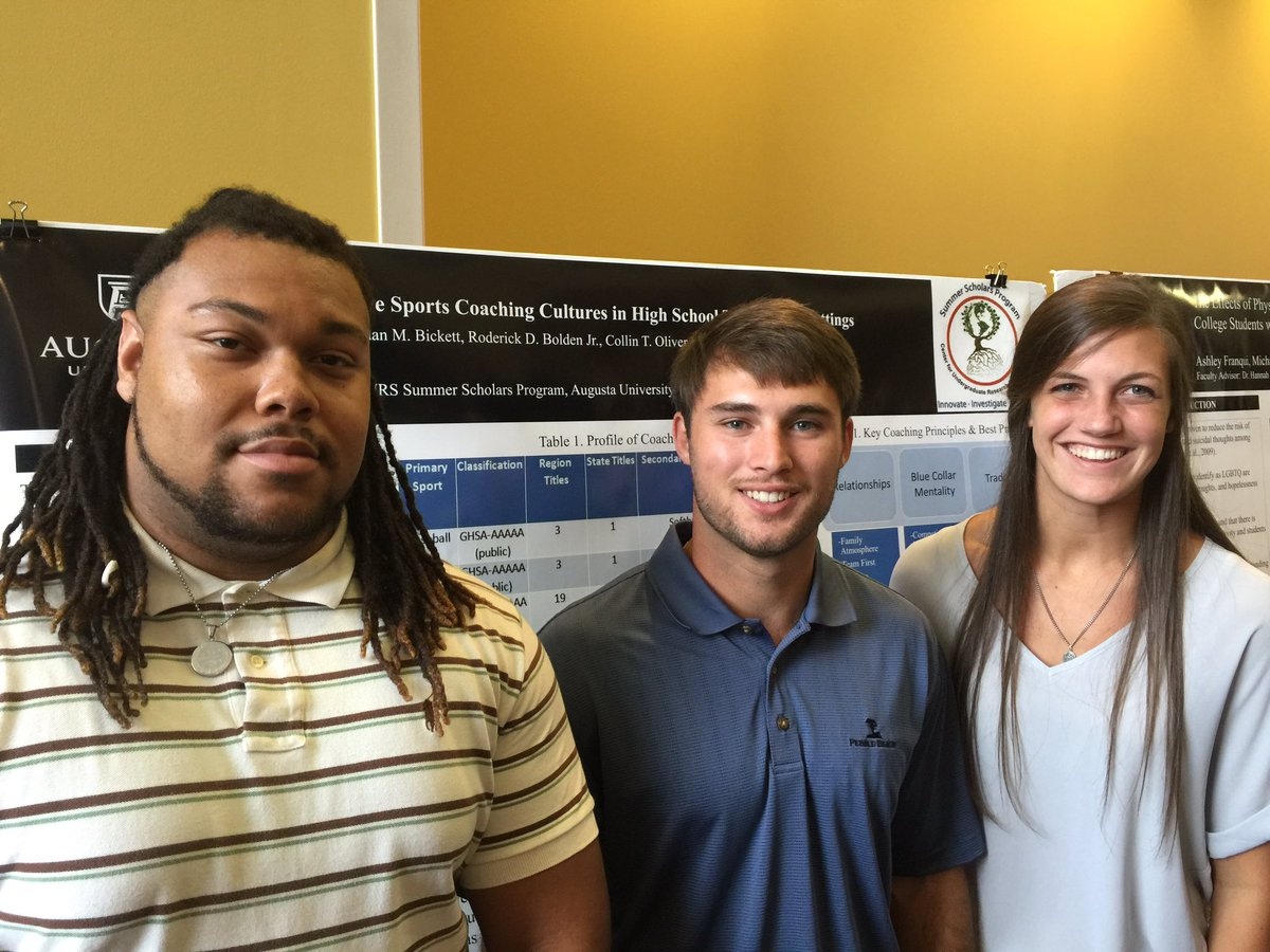Dr. Graeme Connolly (not pictured) lead students Roderick Bolden Jr. (from left), Jordan Bickett and Collin Oliver in investigating Effective Sports Coaching Cultures in High School Team Sport Settings.