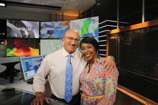 Photo by The Weather Channel. Alana Leverette with meteorologist Jim Cantore in the studio.