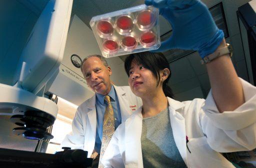 Weintraub with researcher