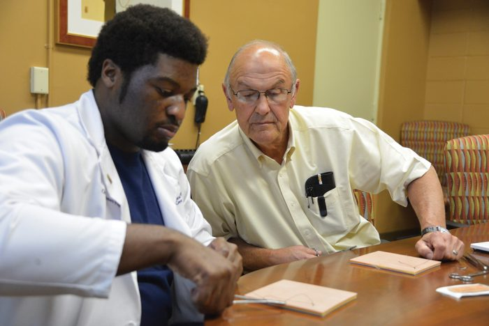 Dr. Bill Pannell (right) works with an MCG student at the Southwest Campus offices in Albany.