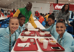 Pardon Ndhlovu meets U.S. gymnasts Simone Biles, Gabby Douglas, Madison Kocian and Laurie Hernandez. Courtesy of Pardon Ndhlovu.